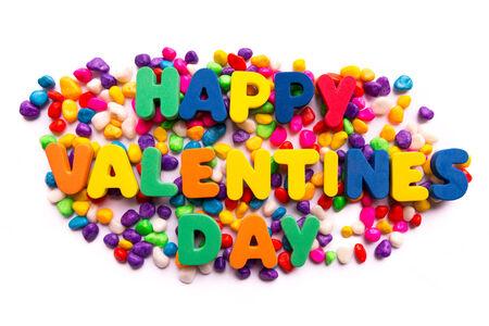 happy valentines: happy valentines day word in colorful stones Stock Photo