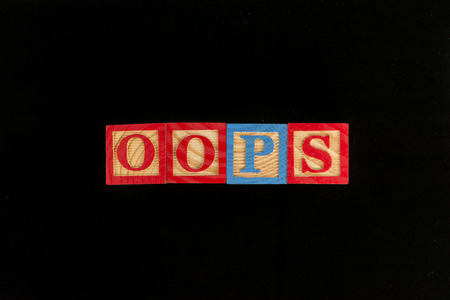 oops word in black background Stock Photo