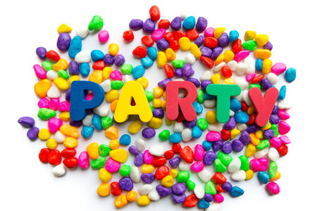 filming point of view: party word in colorful stone Stock Photo