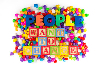 demanding: People want to change words in colorful stone Stock Photo