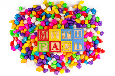 myth: Myth fact words in colorful stone