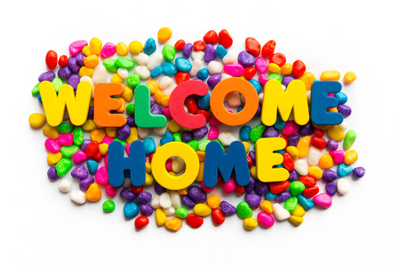 neighborly: welcome home word in colorful stone Stock Photo