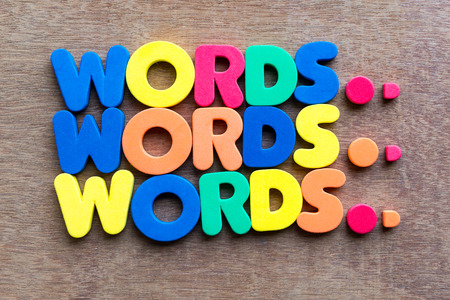 words in wood background photo