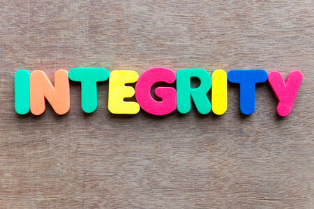 integrity word on wooden background photo