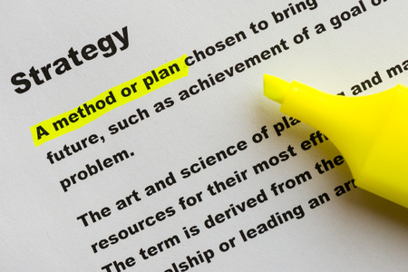 felt tip pen: The word Strategy highlighted in yellow with felt tip pen. Stock Photo