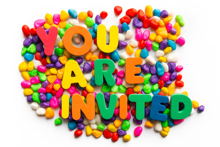 invited: you are invited words on colorful stone