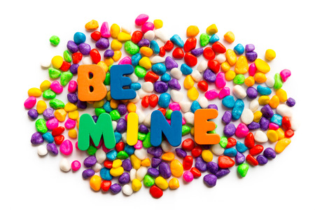 be mine: be mine word on colorful stone