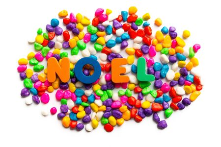 noel word on colorful stone photo