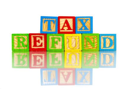 tax refund: tax refund words reflection on white background Stock Photo