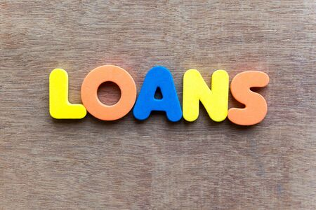 loans: loans colorful word in the wooden background