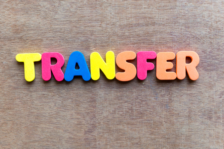 budgetary: transfer colorful word in the wooden background