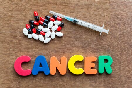 cancer colorful word in the wooden background