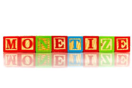 monetizing: monetize word reflection on white background