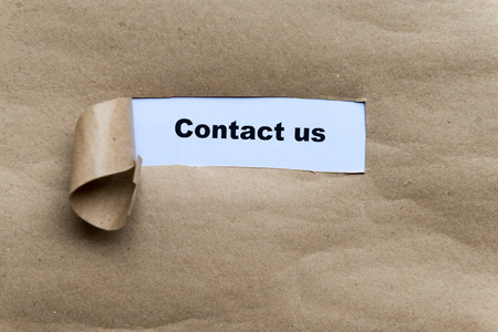 contactus: contact us word in grey Torn Paper Concept