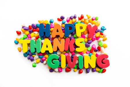 happy thanksgiving colorful word on the white background photo