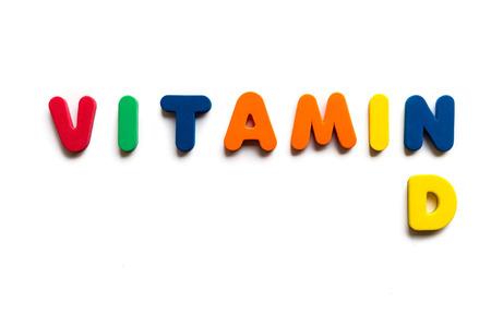 白の背景にカラフルな単語をビタミン d