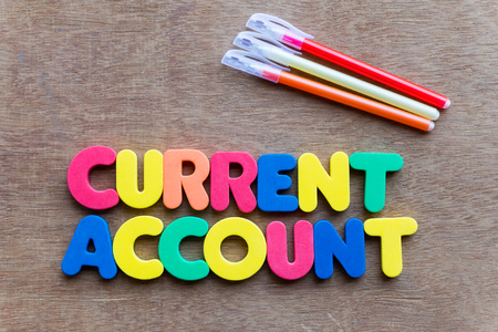 current account: current account colorful word on the wooden background