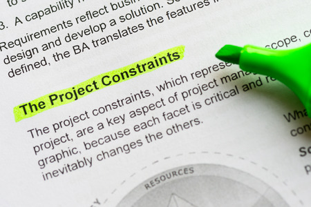 constraint: the project constraint sentence highlighted by green marker Stock Photo