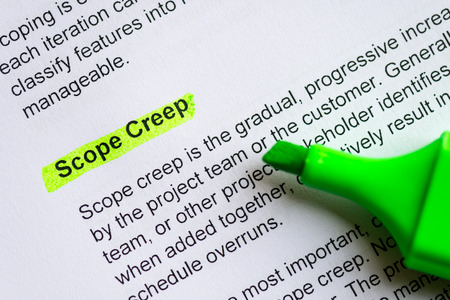 to creep: scope creep sentence highlighted by green marker Stock Photo