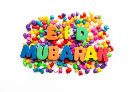 gifting: eid mubarak colorful word on the white background