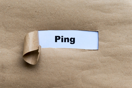 ping word on the torn paper background photo
