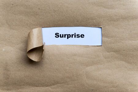 disconcert: surprise word on the torn paper background Stock Photo