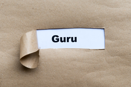 reputable: guru word on the torn paper background Stock Photo
