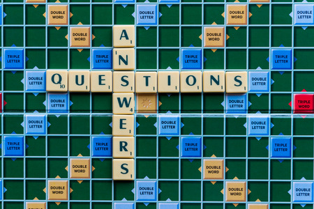 questions: questions and answers Crossword on the colorful game board Stock Photo