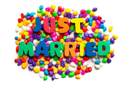 short phrase: Just Married words on the colorful stone and white background