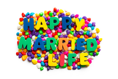 happy married life words on the colorful stone and white background photo