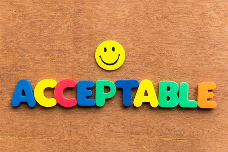 acceptable: Acceptable colorful word on the wooden background Stock Photo