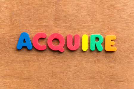 procure: acquire colorful word on the wooden background