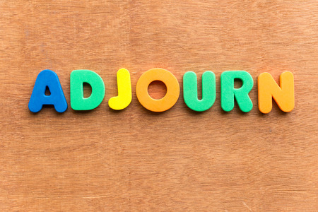 arbitration: adjourn colorful word on the wooden background