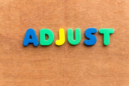 rectify: adjust colorful word on the wooden background Stock Photo