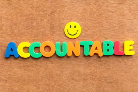 accountable: accountable colorful word on the wooden background