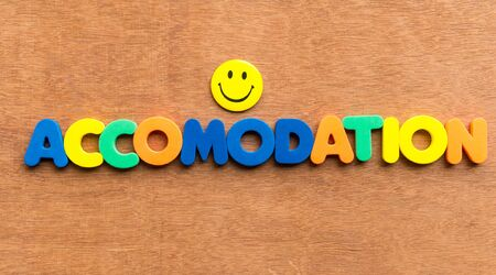 accomodation: accomodation colorful word on the wooden background
