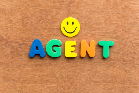 obliged: agent colorful word on the wooden background