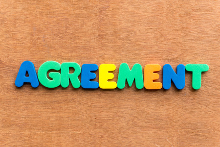 agreement colorful word on the wooden background Reklamní fotografie