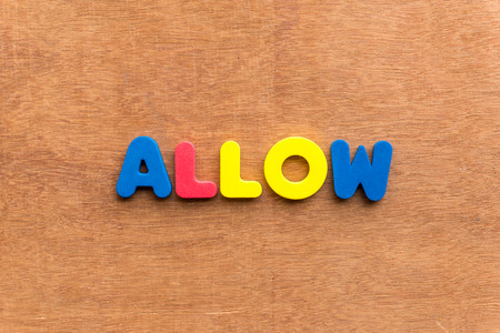 allow: allow colorful word on the wooden background