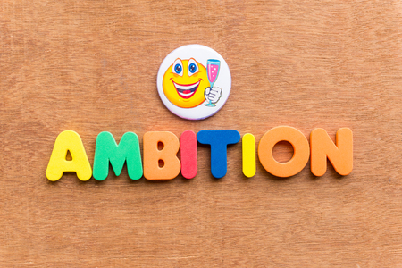 ambition: ambition colorful word on the wooden background
