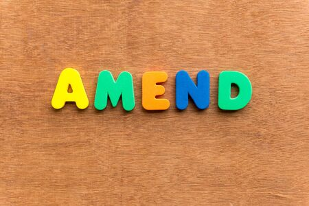 rectify: amend colorful word on the wooden background