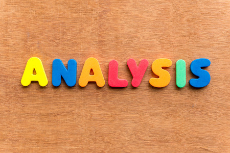 dissection: analysis colorful word on the wooden background