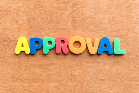 endorsement: approval colorful word on the wooden background Stock Photo
