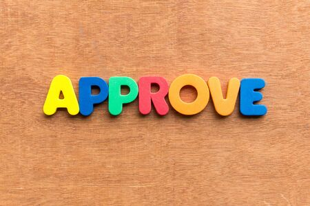 approve colorful word on the wooden background photo