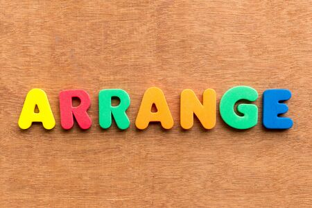 arrange colorful word on the wooden background photo