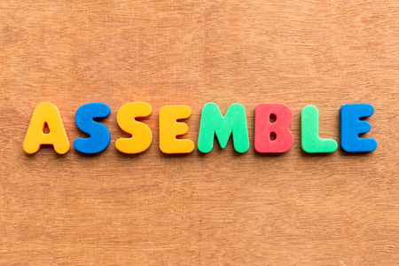 assemble: assemble colorful word on the wooden background