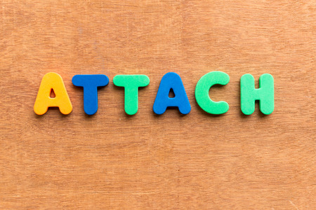 attach: attach colorful word on the wooden background