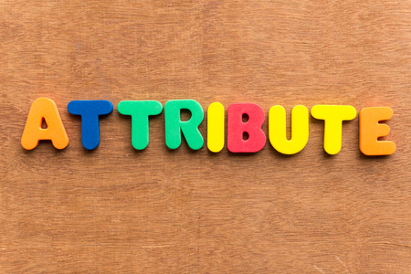 attribute colorful word on the wooden background Stock Photo