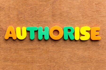 authorise: authorise colorful word on the wooden background