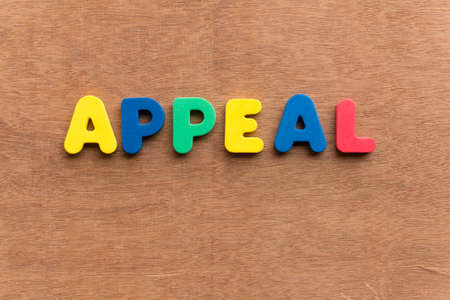 appeal colorful word on the wooden background Stock Photo
